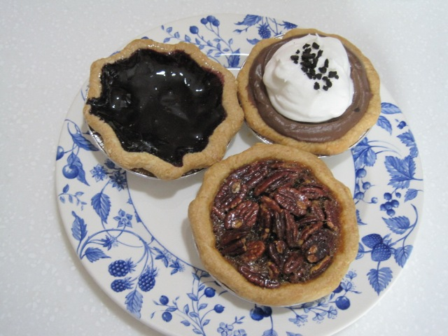 My friends pecan, chocolate cream, and blueberry.